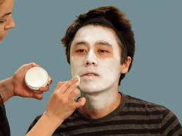 applying white makeup base for skeleton