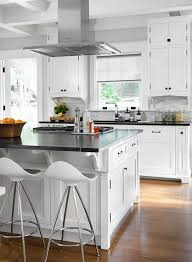 white kitchen island with soapstone countertops