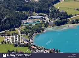 austria view red bull. Austria, Salzburg State, Salzkammergut, Fuschl Am See, View To Seaside Resort And Red Bull Headquarter At Lake Fuschlsee Austria