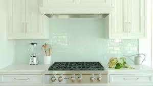 white kitchen cabinets with blue glass tile backsplash shell mosaic
