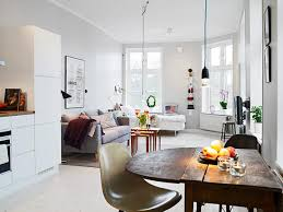 Small Apartment in Gothenburg Showcasing an Ingenious Layout Shop this  look: table, couch, nesting tables.