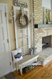 old door leaning against the wall fits in with ease paired with the rustic wooden home sign and the rustic wreath made with branches