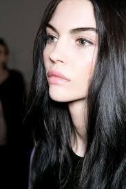 dark brown black hair with green hazel eyes and pale skin natural makeup backse clean dewy skin dark brows