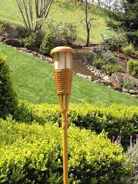 lighting tiki torches. see larger image lighting tiki torches i