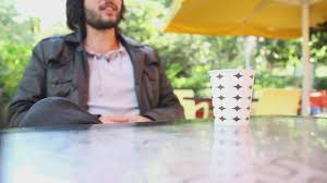 Business woman in new york drinking coffee. Man Talking Drinking Coffee Outside Free Stock Video Mixkit