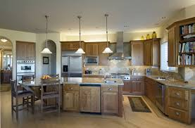 Contemporary Kitchen Design With Long Island With A Round Eating Section On  One End.