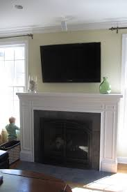 fireplace mantel remodel with white molding