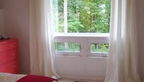 Hanging Blinds Above Window