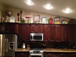 decorations on top of kitchen cabinets. Kitchen Decorating Above Cabinets White Counter Wooden Set Cream Marble Countertop Brown Color Granite Larga Size Decorations On Top Of