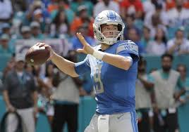 detroit lions quarterback matthew stafford 9 looks to pass during the first half