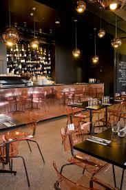 restaurant table top lighting. Baroque Bar Bistro Patisserie, Low Lighting, Dark Table Tops, Huge Copper Bar, Clear Plastic Seats Restaurant Top Lighting
