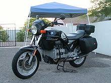 bmw k100 black bmw k75t topbox and panniers parked on a driveway in front of a