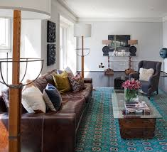 traditional living room design with brown sofas that glass table feat blue carpet which giving nice decoration