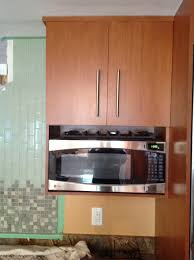 wood wall mounted microwave shelf storage under cabinet with door and stainless steel handle for small kitchen spaces in the corner ideas