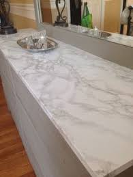 Faux marble contact paper covers damaged dresser top. Looks real!