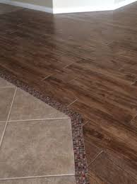 perfect gl stone mosaic transition from the tile to the wood look porcelain tile