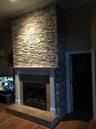 fireplace facing adds atmosphere creative faux panels stacked stone project complete home decor ideas on