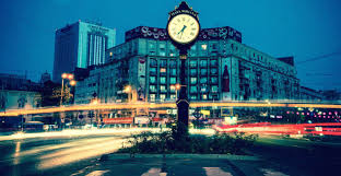 how to build a career in international development job a long exposure photograph of a clock tower at night in a european city as
