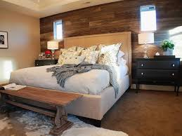rustic bedroom with reclaimed wood wall