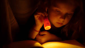 Image result for child reading flashlight
