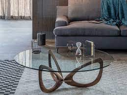 Glass coffee tables are modern and elegant, while also creating the illusion of space because of its clarity and transparent nature. Modern Coffee Tables With Round Glass Tops And Timeless Designs