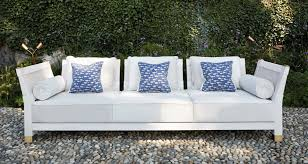 moltrasio is an outdoor wooden sofa with bronze feet and details from promemoria s outdoor catalogue