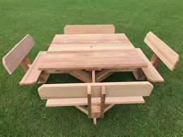 wooden square picnic tables with attached benches