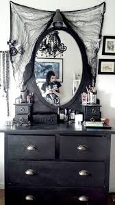 Black dresser with mirror, net decor around, perfect for your gothic horror  or Wicca bedroom