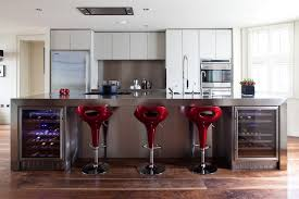 Comfortable and stylish bar stools. Red bar stools bring this kitchen ...