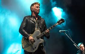queens of the stone age are giving away free tickets to madison square garden show on the new york subway nme