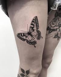 Black Ink Butterfly On Girls Thigh Best Tattoo Design Ideas