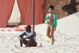 usain bolt and friend kasi bennett enjoy romantic break on the beach in mexico