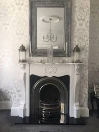 white cast iron fireplace with granite hearth