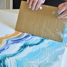 23 mix paint tones using a piece of cardboard and create a wave effect