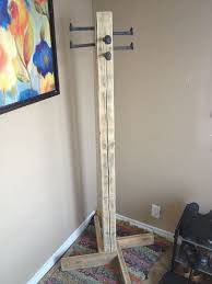 How To Make A Free Standing Coat Rack DIY Free Standing Coat Rack I'd use pretty hooks for a different 2