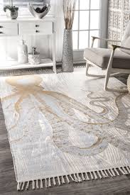 thomas paul metallic octopus tassel rug ivory