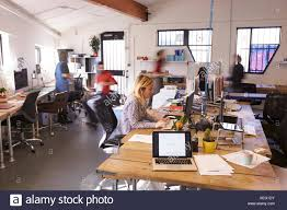 office building interior busy. Perfect Office Interior Of Busy Design Office With Staff In Building B