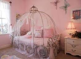 OMGGGG my dream bedroom as a kid. i woulda killed for this room! Princess  themed bedroom with Cinderella carriage bed