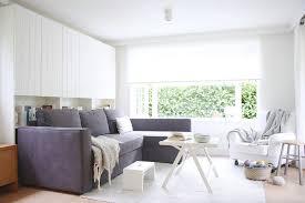 kirklands mobile al scandinavian living room and dark gray sectional sofa folding coffee table large window