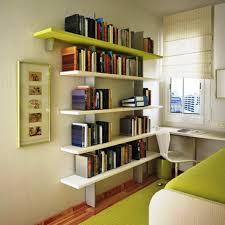 Small Teenage Bedroom with Floating Bookshelf and Green Rug