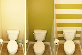 transform a small bathroom with stripes this step by step tutorial will help you use diy contact paper wall stripes will