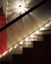 stairwell lighting ideas. night light a small reflective sconce and shimmering frosted votives offer romantic alternative to overhead lighting in this minimalist stairwell ideas