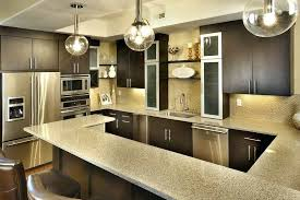 breathtaking hanging lights above kitchen island with glass globe pendant light shade also two level breakfast
