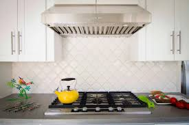 kitchen backsplash stainless steel tiles: pictures of white kitchens with arabesque backsplash tile tile backsplash stainless steel range hood white