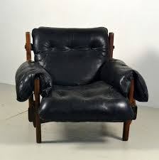 early moleca mischievous lounge chair by sergio rodrigues in black leather
