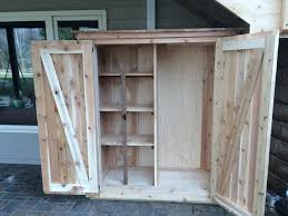 balcony storage cabinet cedar deck louvered roof patio cover and custom storage cabinet in