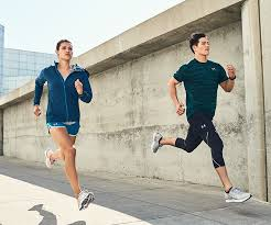under armour tracksuit. a man and woman running whilst modelling under armour clothing footwear tracksuit t