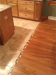 removing tile glue from hardwood floors transition between hardwood and tile floor we should do this