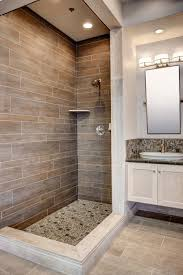 a faux wood tile shower featuring dyrewood cinnamon faux wood thetile woodliketile