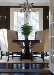 elegant dining room with chocolate brown walls paint color french doors chocolate brown pedestal dining table camel linen dining chairoravian star